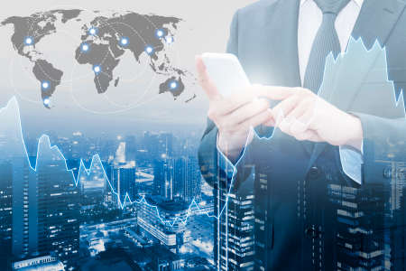 international banking: Double exposure of professional businessman connect internet smart phone and cityscape of business centre with international world financial graph, Business , finance , trading and banking concept , world map element of this image furnished by NASA Stock Photo
