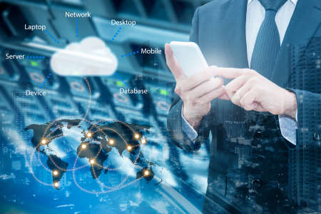 Double exposure of professional businessman connecting cloud internet smart phone with servers technology and connect world network in IT Business concept, Stock Photo