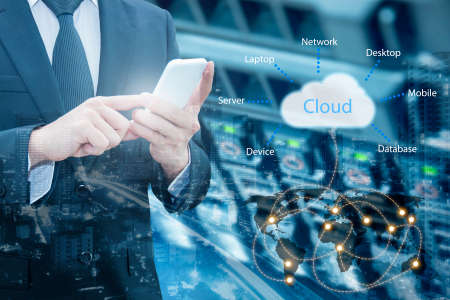 Double exposure of professional businessman connecting cloud internet smart phone with servers technology and connect world network in IT Business concept, Foto de archivo