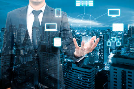 Double exposure of professional businessman connecting cloud technology on hand with cloud and sky in Technology, Communication and business concept