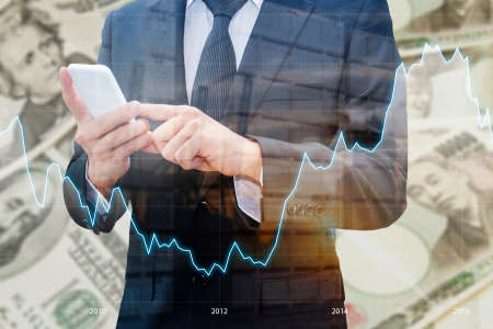 Double exposure of businessman using smart phone , Financial graph and transportation port with Japanese JPY Yen and USD Dollar bank note pile background, Business and finance concept