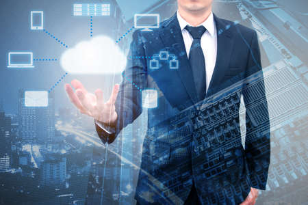 Double expoure of professional businessman connecting cloud technology on hand with servers computer & storage technology in Technology, Communication and business concept Standard-Bild