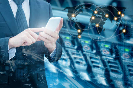 Double exposure of professional businessman connecting internet smart phone with servers technology and connect world network in IT Business concept,