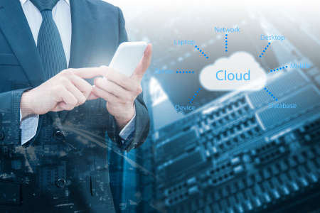 Double exposure of professional businessman connecting cloud internet smart phone with servers technology and connect world network in IT Business concept, Imagens