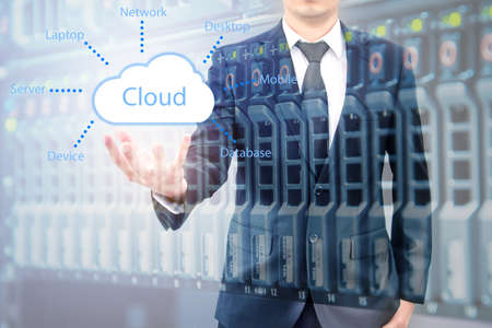 Double expoure of cloud computing concept on hand of a businessman with servers computing technology in datacenter creative cloud concept Stock Photo