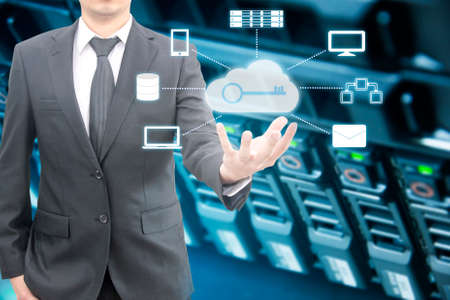 Double expoure of professional businessman connecting cloud technology on hand with cloud and sky in Technology, Communication and business concept 免版税图像