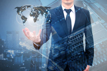 Double expoure of professional businessman connecting internet network on hand with servers computer & storage technology in Technology, Communication and business concept, Stock Photo