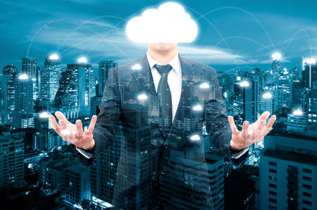Double exposure of professional businessman night cityscape and internet network connection cloud technology for communication , business and technology concept