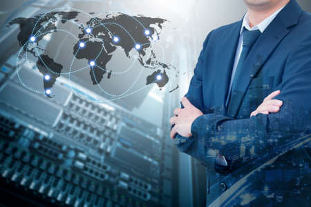 Double exposure of professional businessman standing crossed arms connecting internet with servers storage technology and connect world network in IT Business concept, Standard-Bild
