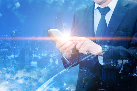advanced computing: Double exposure of professional businessman using cloud technology in smart phone with servers technology in data center and network connection in IT Business technology concept