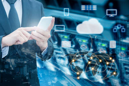 Double exposure of professional businessman connecting cloud internet smart phone with servers and cloud technology connect world network in IT Business concept,