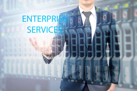 advanced computing: Double expoure of businessman with servers technology in datacenter in IT enterprise services concept