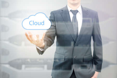 advanced computing: Double expoure of cloud computing concept on hand of a businessman with servers computing technology in datacenter creative cloud concept Stock Photo