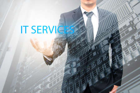 advanced computing: Double expoure of businessman with servers technology in datacenter in IT services concept