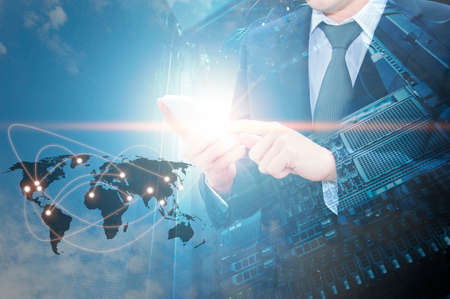 data recovery: Double exposure of professional businessman using cloud in smart phone with servers technology in data center and world map network connection in IT Business concept