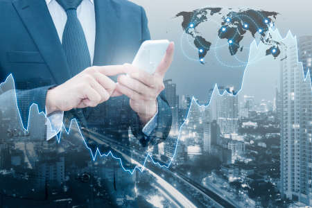 international banking: Double exposure of professional businessman connect internet smart phone and cityscape of business centre with international world financial graph, Business , finance , trading and banking concept,