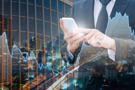 international banking: Double exposure of professional businessman connect internet smart phone and cityscape of business centre with international world financial graph, Business , finance , trading and banking concept