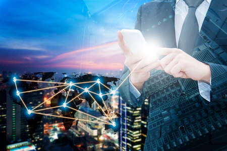 international internet: Double exposure of professional businessman using smart phone with servers technology in data center , city center of business and world map network connection in IT Business concept Stock Photo