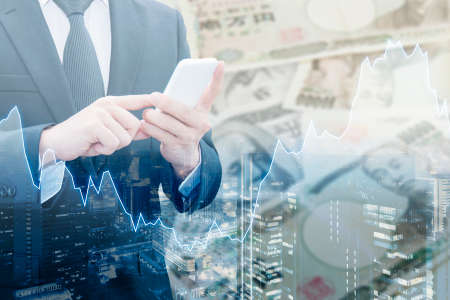 Double exposure of businessman connect internet network, Financial graph and cityscape with Japanese JPY Yen bank note pile background, Trading , Business and finance concept Standard-Bild