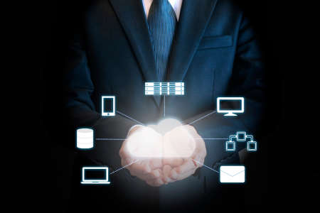 Professional businessman connecting network on hands in Cloud technology, communication and business concept Standard-Bild