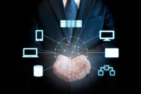 Professional businessman connecting network on hands in Cloud technology, communication and business concept Banque d'images