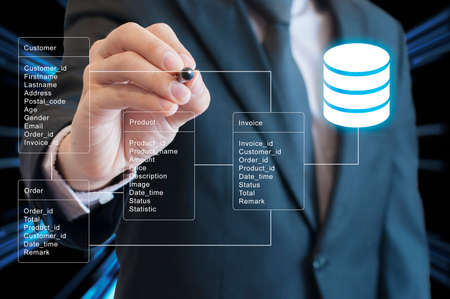Professional businessman system analysis design and drawing database table with futuristic background Foto de archivo