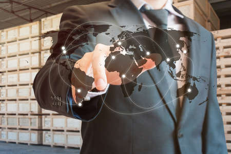 Double exposure of businessman touch screen on map to transport products at logistics port background, transportation trading business concept, world map element of this image furnished by NASA