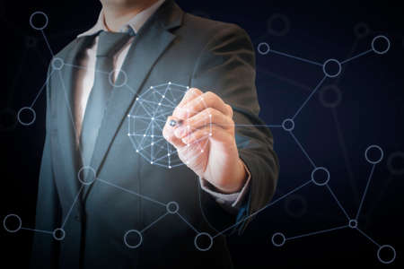 Double exposure of professional businessman touching virtual screen on a digital interface to connect world network in business and technology concept Foto de archivo