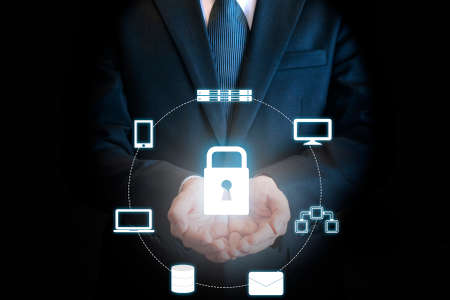 Double expoure of professional businessman protecting cloud technology on hand in security technology and business concept Standard-Bild