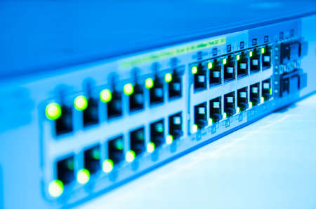 Network switch online green status in blue tone with depth of field