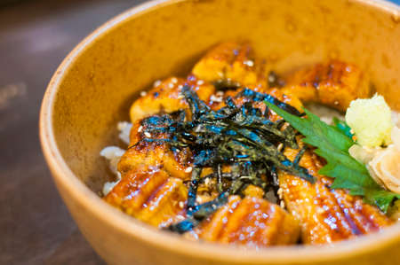 Famous of Japanese food , closed up Unagi on top Japanese rices in bowl , Grilled eel in the restaurant