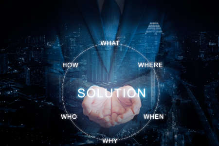 Double exposure of Professional businessman in blue tone background hold SOLUTION on hand in business concept Stock Photo