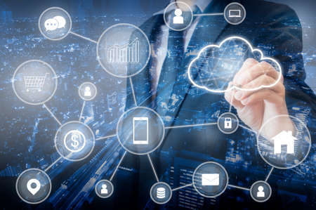 Double exposure of Professional businessman connecting cloud technology network and devices on hand in internet of things , technology , communication and business concept