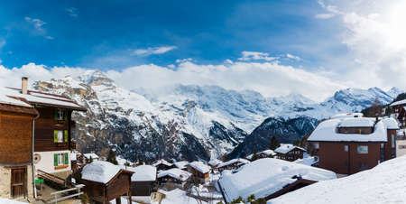 Panoramic view of the house covered with snow at Murren old Village with the snow mountains