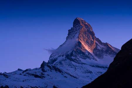 Closeup the famous Matterhorn peak snow mountain landscape in sunset at Gornergrat station in Zermatt, Switzerland