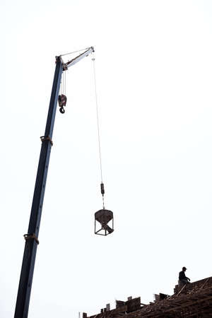 hoists: Cranes with rope hoists and lifting heavy objects  Stock Photo
