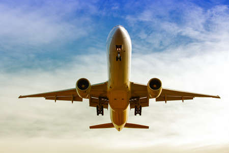 maneuvering: Bottom view of the landing maneuver of a commercial plane Stock Photo