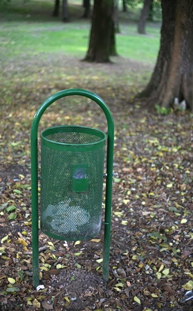 green garbage can in a park. photo