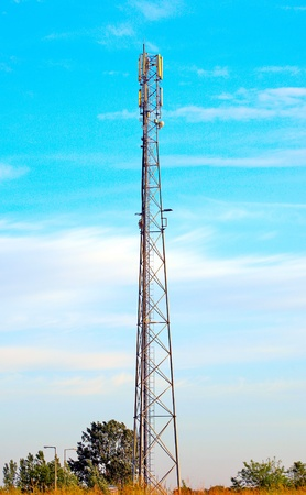 Telecommunication tower in the blue sky. Stock Photo - 13920015