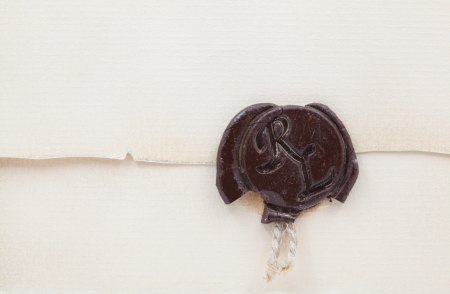 Old envelope with wax seal and rope. photo