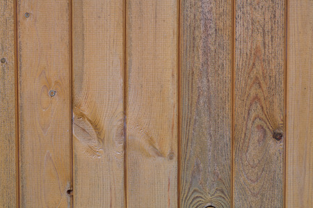 structural background of old, laminated, wooden board in a vertical plane