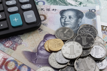 calculator chinese: Chinese money (RMB) and a calculator. Business or holiday concept.