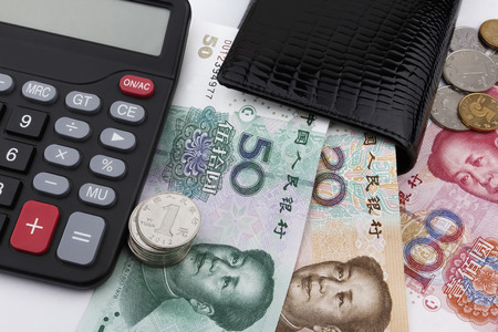 calculator chinese: Chinese money (RMB),  a calculator and a black wallet. Business concept.