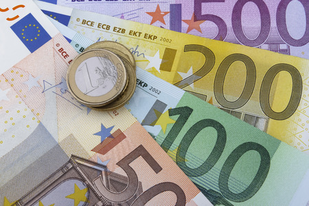 1 euro: Euros (EUR) coins and notes. 50, 100, 200 and 500 Euro notes. 1 Euro coin on the left. Stock Photo