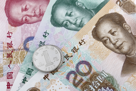 rmb: Chinese money (RMB). 20, 50 and 100 RMB note, with a 1 RMB coin on top. Stock Photo