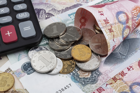 calculator chinese: Chinese money (RMB) notes, coins and a calculator. Business  concept.