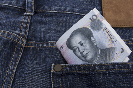 rmb: Chinese money (RMB) 10 RMB note in a pocket of a pair of blue jeans Stock Photo