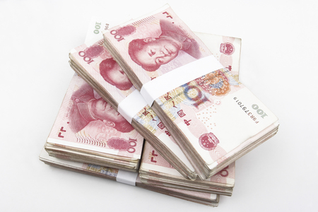 rmb: Chinese 100 RMB banknotes Stacked, on a white background.