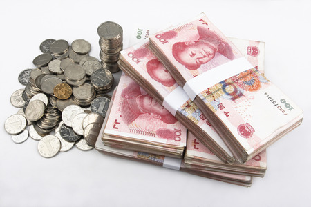 savings and loan crisis: Stacked Chinese 100 notes with coins in the left side.