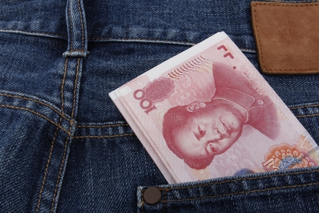 rmb: Chinese money (RMB) 100 RMB note in a pocket of a pair of blue jeans
